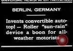 Image of man driving car Berlin Germany, 1930, second 7 stock footage video 65675052012