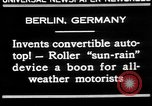Image of man driving car Berlin Germany, 1930, second 8 stock footage video 65675052012