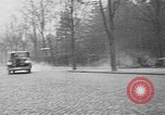 Image of man driving car Berlin Germany, 1930, second 10 stock footage video 65675052012