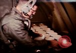 Image of crewman aboard AC 47 aircraft Vietnam Bien Hoa Air Base, 1967, second 8 stock footage video 65675052034