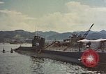 Image of American sailors examine Japanese submarines Yokosuka Japan Yokosuka Harbor, 1945, second 3 stock footage video 65675052130