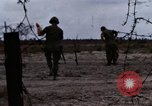 Image of United States soldiers Vietnam Bien Hoa Air Base, 1968, second 4 stock footage video 65675052302