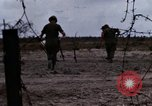 Image of United States soldiers Vietnam Bien Hoa Air Base, 1968, second 5 stock footage video 65675052302