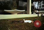 Image of Fallen Vietcong on embassy grounds Saigon Vietnam, 1968, second 3 stock footage video 65675052350