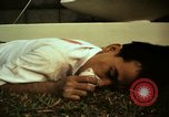 Image of Fallen Vietcong on embassy grounds Saigon Vietnam, 1968, second 11 stock footage video 65675052350