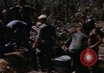 Image of American soldiers at captured VC tunnel complex Vietnam, 1968, second 9 stock footage video 65675052380