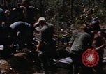 Image of American soldiers at captured VC tunnel complex Vietnam, 1968, second 10 stock footage video 65675052380