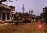 Image of wrecked buildings Saigon Vietnam, 1968, second 7 stock footage video 65675052385