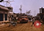 Image of wrecked buildings Saigon Vietnam, 1968, second 8 stock footage video 65675052385