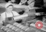 Image of war production workers at Douglas Aircraft Long Beach California USA, 1942, second 6 stock footage video 65675052406