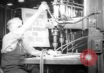 Image of old men work on grinders Long Beach California USA, 1942, second 1 stock footage video 65675052407