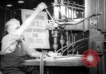 Image of war production workers at aircraft factory Long Beach California USA, 1942, second 2 stock footage video 65675052407