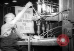 Image of old men work on grinders Long Beach California USA, 1942, second 3 stock footage video 65675052407