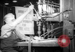 Image of old men work on grinders Long Beach California USA, 1942, second 4 stock footage video 65675052407