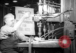 Image of old men work on grinders Long Beach California USA, 1942, second 5 stock footage video 65675052407