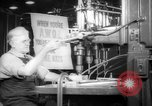 Image of old men work on grinders Long Beach California USA, 1942, second 6 stock footage video 65675052407