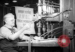 Image of old men work on grinders Long Beach California USA, 1942, second 7 stock footage video 65675052407