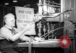 Image of old men work on grinders Long Beach California USA, 1942, second 8 stock footage video 65675052407