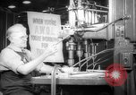 Image of old men work on grinders Long Beach California USA, 1942, second 10 stock footage video 65675052407