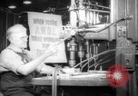 Image of old men work on grinders Long Beach California USA, 1942, second 11 stock footage video 65675052407
