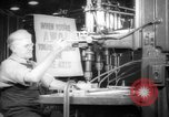 Image of old men work on grinders Long Beach California USA, 1942, second 12 stock footage video 65675052407
