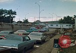 Image of trucks hauling wrecked cars Rapid City South Dakota USA, 1972, second 9 stock footage video 65675052517