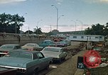 Image of trucks hauling wrecked cars Rapid City South Dakota USA, 1972, second 10 stock footage video 65675052517