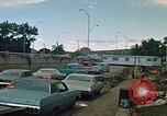 Image of trucks hauling wrecked cars Rapid City South Dakota USA, 1972, second 11 stock footage video 65675052517