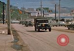 Image of convoy of National Guard trucks Rapid City South Dakota USA, 1972, second 5 stock footage video 65675052523