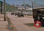 Image of convoy of National Guard trucks Rapid City South Dakota USA, 1972, second 7 stock footage video 65675052523