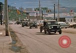 Image of convoy of National Guard trucks Rapid City South Dakota USA, 1972, second 9 stock footage video 65675052523