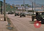 Image of convoy of National Guard trucks Rapid City South Dakota USA, 1972, second 10 stock footage video 65675052523