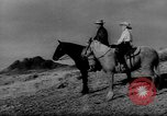 Image of cowboys United States USA, 1968, second 2 stock footage video 65675052587