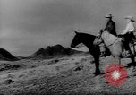Image of cowboys United States USA, 1968, second 3 stock footage video 65675052587