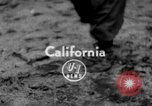 Image of men outside houses Sierra Madre California USA, 1954, second 1 stock footage video 65675052625