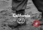Image of men outside houses Sierra Madre California USA, 1954, second 3 stock footage video 65675052625