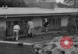 Image of men outside houses Sierra Madre California USA, 1954, second 11 stock footage video 65675052625