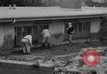 Image of men outside houses Sierra Madre California USA, 1954, second 12 stock footage video 65675052625