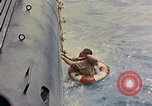 Image of US submarine rescues Japanese survivors at sea Pacific Ocean, 1945, second 8 stock footage video 65675052639