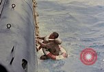 Image of US submarine rescues Japanese survivors at sea Pacific Ocean, 1945, second 9 stock footage video 65675052639