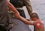 Image of US submarine rescues survivors from Japanese boat Pacific Ocean, 1945, second 8 stock footage video 65675052640