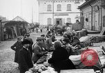 Image of US soldiers visit an open air market Archangel Russia, 1918, second 2 stock footage video 65675053036