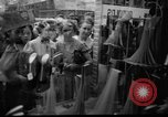 Image of women buying silk stockings during war ration United States USA, 1942, second 3 stock footage video 65675053064