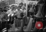 Image of women buying silk stockings during war ration United States USA, 1942, second 7 stock footage video 65675053064