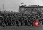 Image of military parade in town Russia, 1916, second 4 stock footage video 65675053078