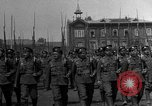 Image of military parade in town Russia, 1916, second 8 stock footage video 65675053078