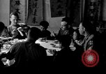 Image of American soldiers dine with Chinese children China, 1943, second 1 stock footage video 65675053427