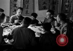 Image of American soldiers dine with Chinese children China, 1943, second 3 stock footage video 65675053427