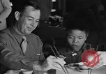 Image of American soldiers dine with Chinese children China, 1943, second 12 stock footage video 65675053427