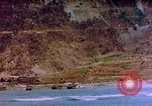 Image of Rocky shoreline Okinawa Pacific Theater Kerama Retto, 1945, second 9 stock footage video 65675053456